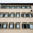 Stock Photo: Old ItaliHotel with Green Shutters