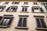 Old Plaster Building with Brown Shutters — Stock Photo