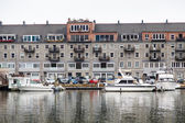 Nice Boats Docked by Old Hotel — Stock Photo