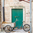 Three Wheeled Bike with Cart by Green Door — Stock Photo
