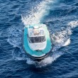Stock Photo: Green and White Pilot Boat on Blue Water