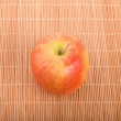 Stock Photo: Single GalApple on Bamboo Placemat