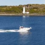 White Yacht Past Lighthouse — Stock Photo