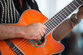 Man Strumming Guitar — Stock Photo