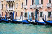 Black and Blue Gondolas Along Venice Canal — Stock Photo