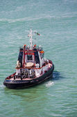 Tugboat Motoring Away — Stock Photo