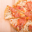 Sliced Pepperoni Pizza on Wood Cutting Board with Copy Space — Stock Photo #45073979