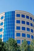 Round Stone Building with Blue Windows — Stock Photo