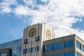 Clock on Office Building — Stock Photo
