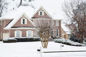 Brick Home and Lawn in Snow — Stock Photo
