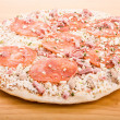 Frozen Pepperoni Pizza on Wood Cutting Board — Stock Photo #46017933