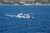 Two Pilot Boats Circling in Blue Water — Stock Photo