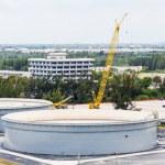 Concrete Tanks and Yellow Crane — Stock Photo #47871965