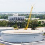 Concrete Tanks and Yellow Crane — Stock Photo