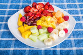 Cut and Sliced Fruit on a Square White Plate — Stock Photo