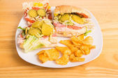 Italian Sub wit Pickle Slices and Mustard — Stock Photo