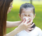 Asian girl with flu — Stock Photo