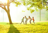 Asian family outdoor fun — Stock Photo