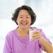 Healthy Senior Asian and soy milk — Stock Photo #12487339