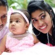 Indian parents and baby girl — Stock Photo