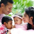 Happy Indian family with two children - Stock Photo