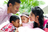 Happy Indian family with two children — Foto de Stock