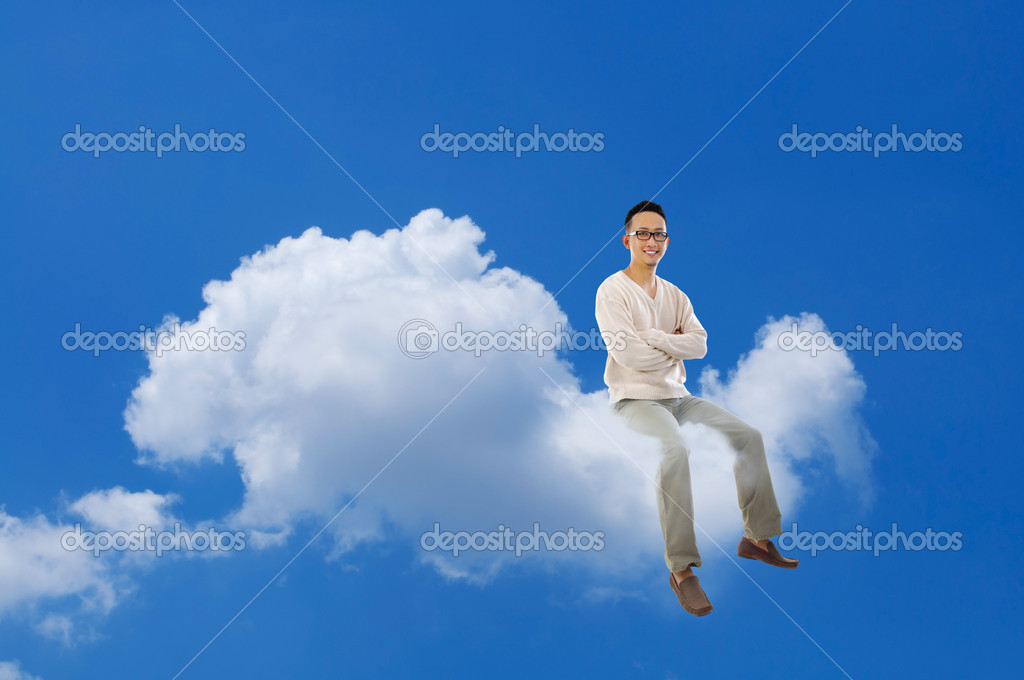 Full body Asian man sitting on a cloud over blue sky — Stock Photo #12655571