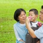 Asian family playing bubble wand — Stock Photo