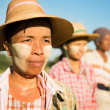 Myanmar farmer standing in row - Stock Photo