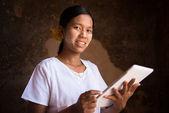 Myanmar girl using tablet computer — Stock Photo