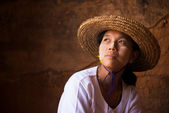 Myanmar girl in straw hot looking away — Stock Photo