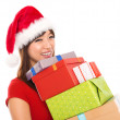 Asian Christmas woman holding gifts — Stock Photo