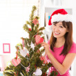 Decorate Christmas tree — Stock Photo