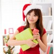 Asian Christmas woman with gift — Stock Photo