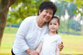 Asian grandparent and grandchild — Stock Photo