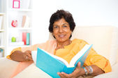 Mature Indian woman reading book — Стоковое фото
