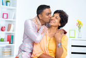 Indian male kissing his mother — Stock Photo