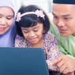 Royalty-Free Stock Photo: Asian family browsing internet