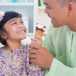 Royalty-Free Stock Photo: Southeast Asian family eat ice cream