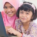 Asian children surfing internet — Stock Photo