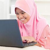 Asian teenager using notebook — Stock Photo