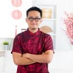 Chinese man standing indoors — Stock Photo #17857831
