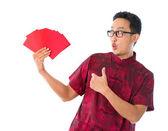 Thumb up Asian Chinese man — Stock Photo