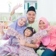 Excited Southeast Asian family - Stock Photo