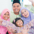 Southeast Asian family quality time at home. - 图库照片