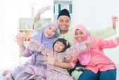 Excited Southeast Asian family — Stock Photo