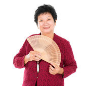 Oriental senior woman with Chinese Fan — Stock Photo