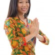 Southeast Asian girl greeting - Stock Photo