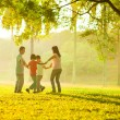 Happy asian family playing on the field — Stock Photo