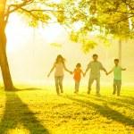 Asian family holding hands running — Stock Photo
